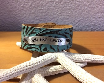 You are Loved Stamped Bracelet on Turquoise/Brown Patterned Leather