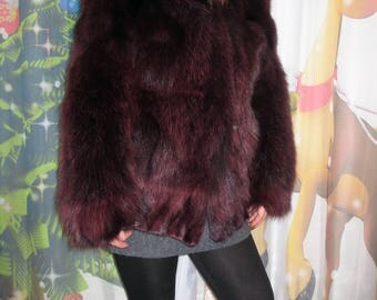 A fur coat from a polar fox with a hood. size S. burgundy color. natural fur.