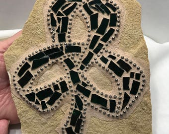 Shamrock, Dark green shamrock mosaic rock has hand cut dark green glass, three leaf clover is surrounded by chain.