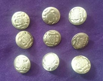 Set of 9 small brass with Crest Coat of arms buttons