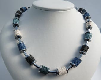 Lava beads, hematite beads and slices, stainless steel closure