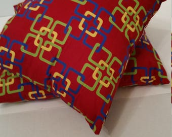 2 African wax print fabric pillows