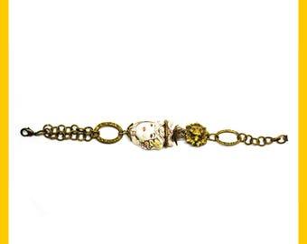 Bracelet in nickel free brass and Sicilian ceramics.