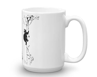 kitty climbing up your mug