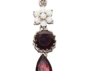 Silver pendant with garnet and opal