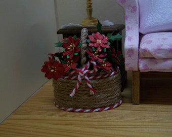 Miniature dollhouse red Christmas poinsettia flowers arranged in a basket