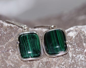 Malachite Earrings. Remarkable pieces of Malachite in a sterling silver setting. Handmade & unique.