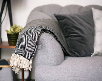 Wool throw in black and ivory