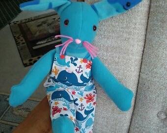 Bunny in blue fleece. 16 long. Bib pants in nautical print. Safety eyes. Hypoallergenic stuffing.