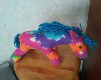 Horse in multicolor fleece for child of any age.  Safety lock eyes. Hypoallergenic stuffing. Yarn main and tail. Measures 13 inches long.