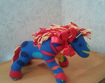 Horse in fleece multicolor. For children of all ages. Hypoallergenic stuffing. Safety lock eyes. Yarn main n tail. Measures 11 long.