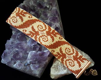 Brown swirls and copper bracelet