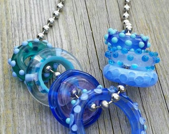 Set of 7 Assorted Handmade Lampwork Glass Ring Beads with 2 FREE Ribbons and Chain   Aquarius Love