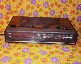 Vintage General Electric wood panel digital alarm clock/radio