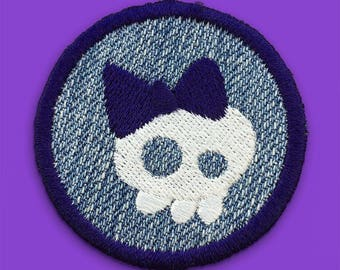 """Round Iron On Patch, Girly Skull with Bow Blue Embroidery on a Denim Background, about 2"""" x 2"""""""