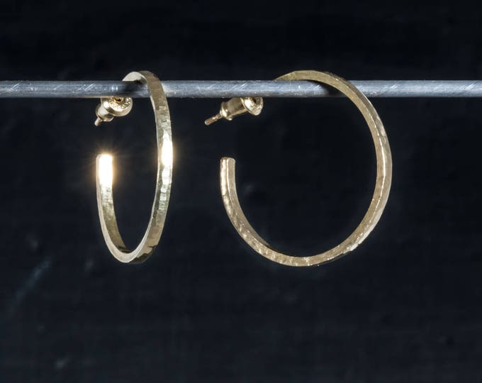 Solid 14k gold hoop earrings 25mm diameter narrow, custom orders available in 18 and 22k gold.
