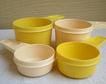 Vintage Tupperware Measuring Cups, replacement cups, toys,  plastic measuring cups,  1970s, yellow and beige