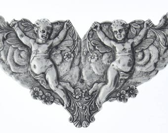 Cherub  Brass Stamping, plated silver and antiqued, sold by each 04213CS