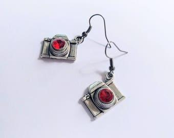 Flashy camera earrings