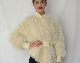 BASIA DESIGNS One of KInd Peplum hand kit jacket in A Faux Fur and Fine yarn blend - Sizes M - XL