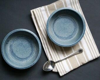 Two minimalist style tapas snack bowls - glazed in smokey blue