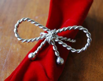 four silvertone napkin rings - bows - cottage chic - traditional