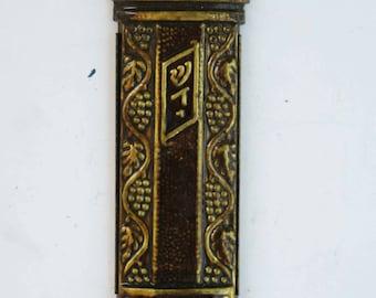 A vintage mezuzah case made in Israel