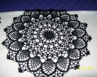 Crocheted round doily in black