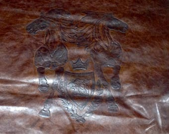 6-706.  Embossed Brown Horse Crest Emblem Leather Cowhide