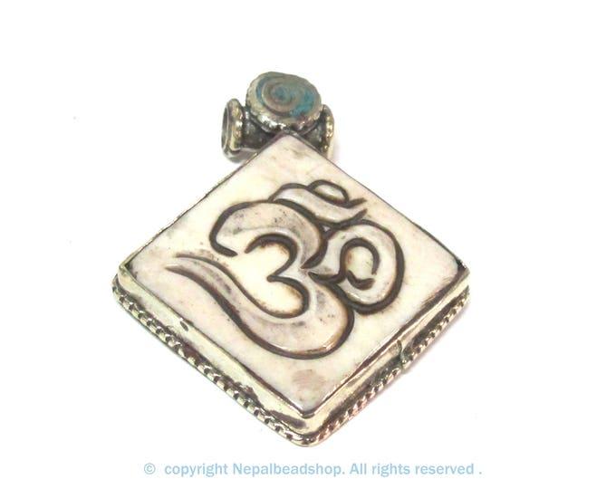Ethnic Tibetan cream color carved Bone Om ohm symbol pendant - PM594C