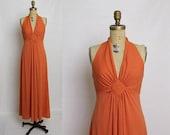 25% OFF 70s halter maxi dress in coral orange
