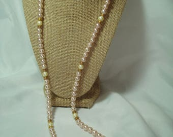 Vintage Pink and Ivory Colored Long Faux Pearl Necklace.