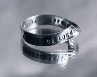 PERSONALIZED MOBIUS solid silver ring. Science meets Art. Custom message hand stamped engraved all around the ring, in an endless way. Rings