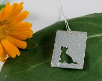 Silver Westie pendant: A cute Westie sits waiting for your attention.