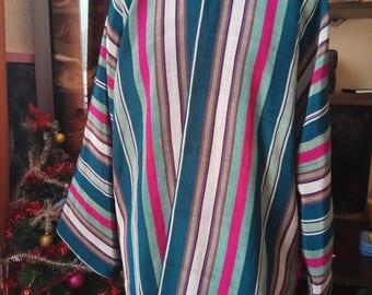 Uzbek traditional silk stripe ikat chapan. Uzbek kaftan, tribal ethnic coat