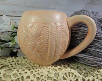 Peach cabled sweater mug