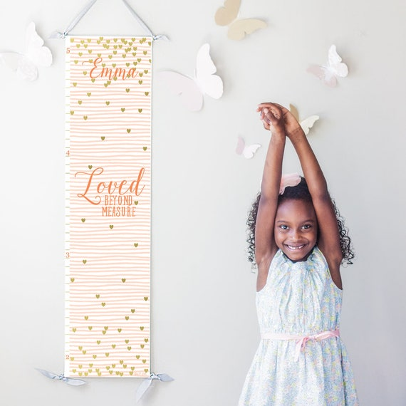 "Personalized ""Loved beyond measure"" canvas growth chart with pink stripes and gold hearts"