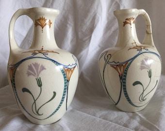 A fine, antique pair of Dutch Arnhem Art Nouveau ceramic jugs.