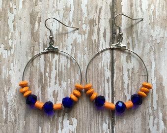 Orange and blue beaded hoop earrings