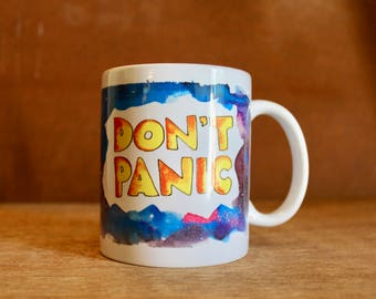 "The Hitchhiker's Guide to the Galaxy Themed Ceramic Mug - Heat-Press Sublimation of Original Artwork - ""Don't Panic"" - ""Hoopy Frood"" - 12 oz"