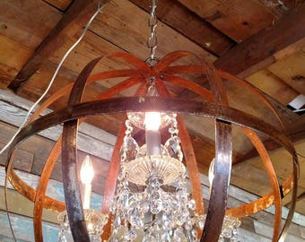 Vintage Crystal Chandelier Floating Inside An Industrial Rustic Hand Crafted Orb