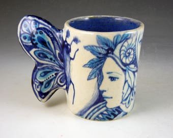 OOAK Butterfly cup porcelain blues and white with faces and butterfly wing handle