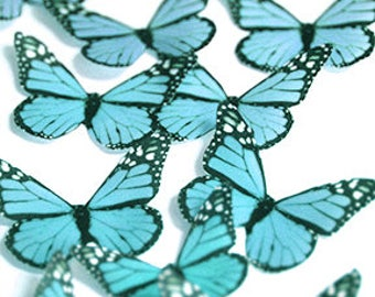 Teal edible butterflies, 12 wafer paper monarch butterflies for cake decorating and cupcake toppers. Butterflies for wedding cake toppers