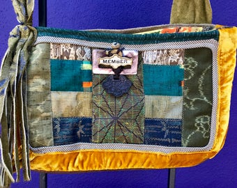 One of a kind rare handmade satchel created with antique Japanese wool kimono textiles with mid-century Tiki motif interior and embellished