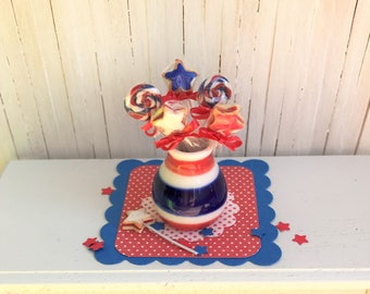 Miniature 4th of July Lollipops and Cookies On A Stick In a Red, White, and Blue Ceramic Jar