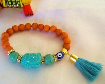 Meditating Buddha bracelet with tassel , turquoise Buddha yoga bracelet , jasper and turquoise meditation bracelet , orange chakra bracelet