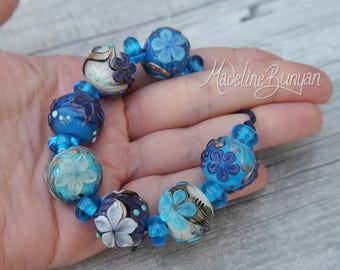 Turquoise, Cream and Purple bright flower rounds Lampwork bead set (7 plus 8 spacers) SRA