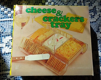 Vintage Clear Lucite Plastic Cheese and Crackers Tray in the original box packaging in Very Good Condition, Made in Hong Kong in the 1970's
