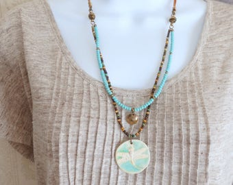 Boho Dragonfly Necklace Ceramic Pendant Long Double Strand Seed Beaded Necklace Turquoise Blue, Cream, Brown Leather Stamped Brass Necklace
