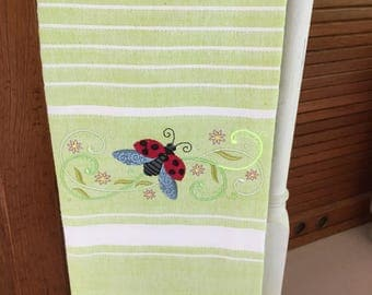 Ladybug green and white striped towel. Machine embroidered. 100% cotton.